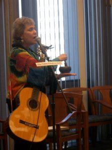 Cheryl Melody singing with Tibetan singing bowl.